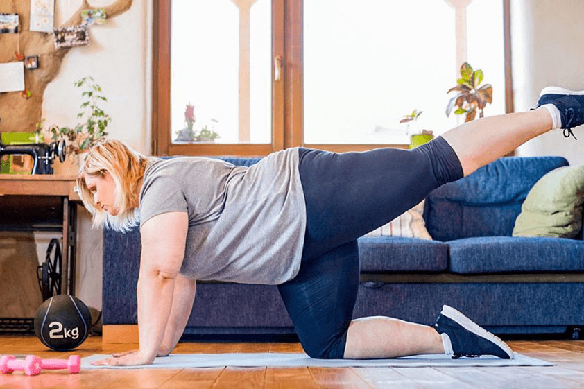 overweight person working out from home
